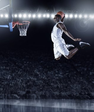 Basketball Player scoring an athletic, amazing slam dunk