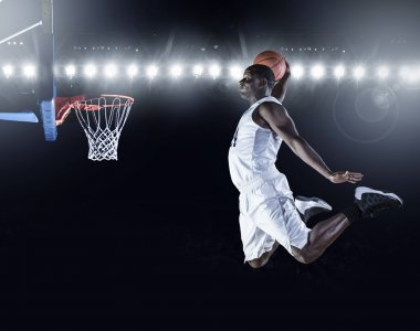 Basketball Player scoring a slam dunk basket.