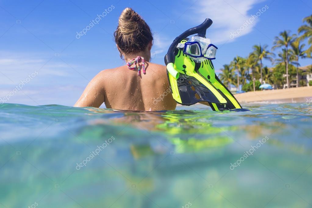 Woman snorkeling in the ocean