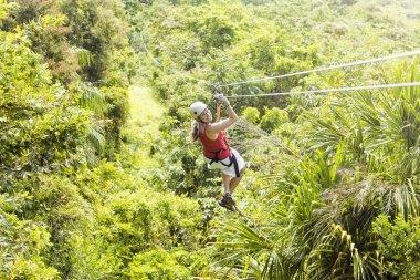 Woman going on a jungle zipline
