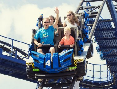 family ride on a roller coaster