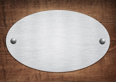 Composition of metal aluminum plaque, name plate on wooden plank
