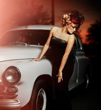 Portrait of beautiful sexy fashion girl model with bright makeup in retro style near old car