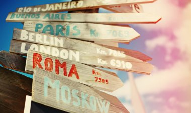 Traffic road  sign including Moscow, Roma,London,Berlin,Paris,Madrid, Rio de Janeiro on blue sky background