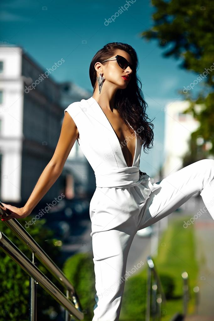 fd0c156b9 Hot sexy beautiful model girl in white suit in sunglasses in the street —  Stock Photo