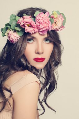 Beauty Girl with Flowers Hairstyle. Beautiful Young Woman