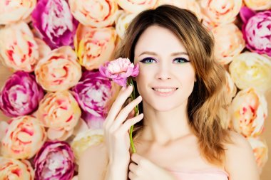 Beautiful Woman Fashion Model. Bright Colorful Makeup and Flowers