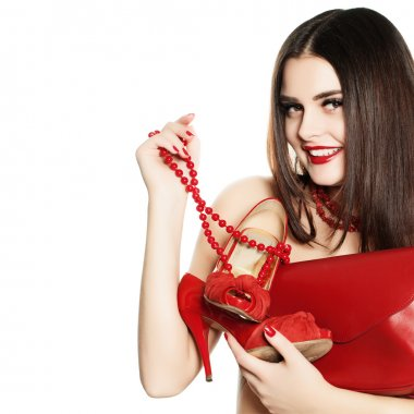 Shopaholic Girl with Red Jewelry, Shoes and Handbags Isolated