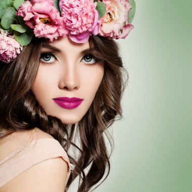 Beautiful Girl with Flowers Wreath. Long Permed Curly Hair and F