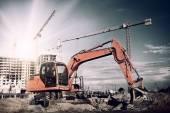 Photo excavator on construction site
