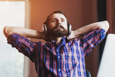 man  in headphones listening to music