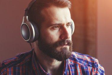 bearded man in headphones