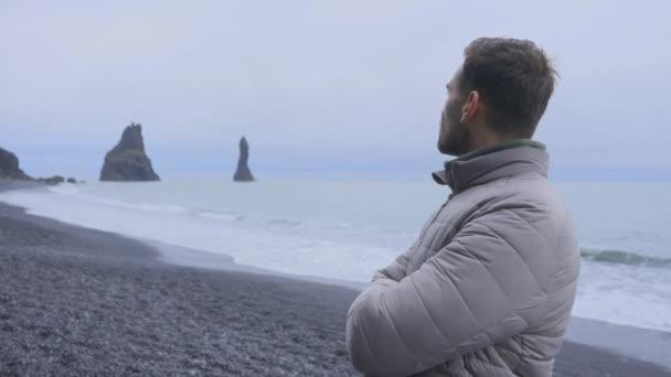 Male Traveler Appreciating the View of the Reynisdrangar Tranquil Ocean