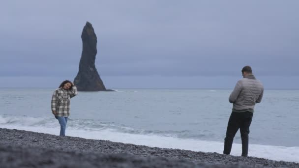 View of Couple Enjoying the Scene by Taking Snapshots on the Reynisfjara Beach