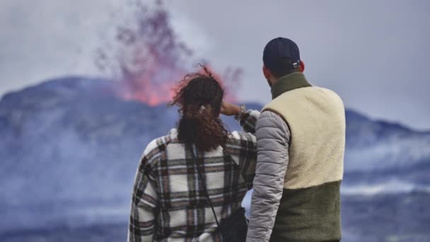 Erupting Volcano as Courageous Adventurers Observe Closely Close Together