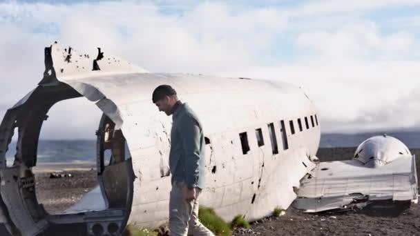 Landscape Shot of Male Model Walking Outside the Solheimasandur Plane Wreck