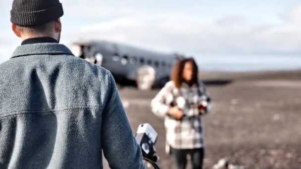 Scenic Shot of Tourists Filming in the Sólheimasandur Plane Crash, Iceland