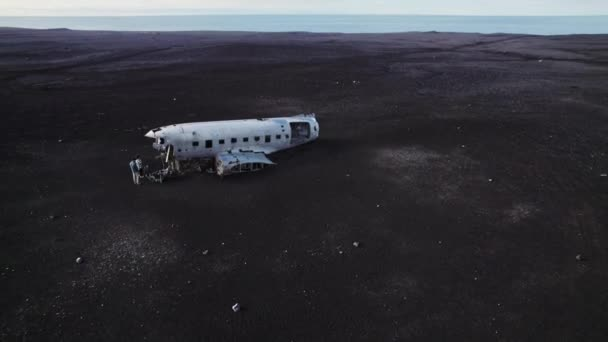 Amazing Drone Shot of Two Travelers Touring Outside the Solheimasandur