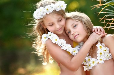 portrait of two sisters twins in tropical style