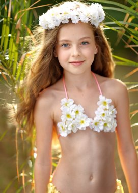 portrait of little girl in tropical style