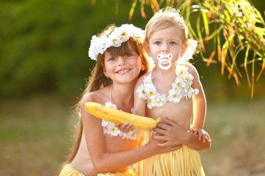 portrait of two girl in tropical style