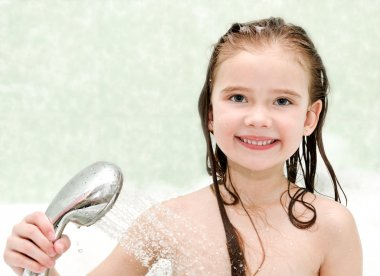 Happy little girl closeup taking shower