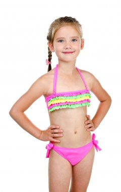 Cute smiling little girl in swimsuit