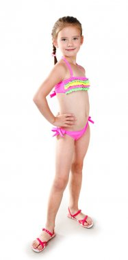 Cute smiling little girl in swimsuit isolated