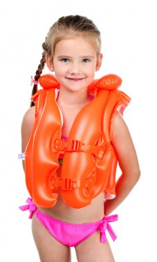 Cute happy little girl in life jacket