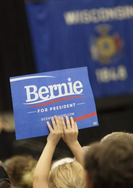 Young Girl Holding up Bernie Sanders Sign at Political Rally