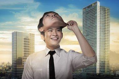 businessman remove his face mask