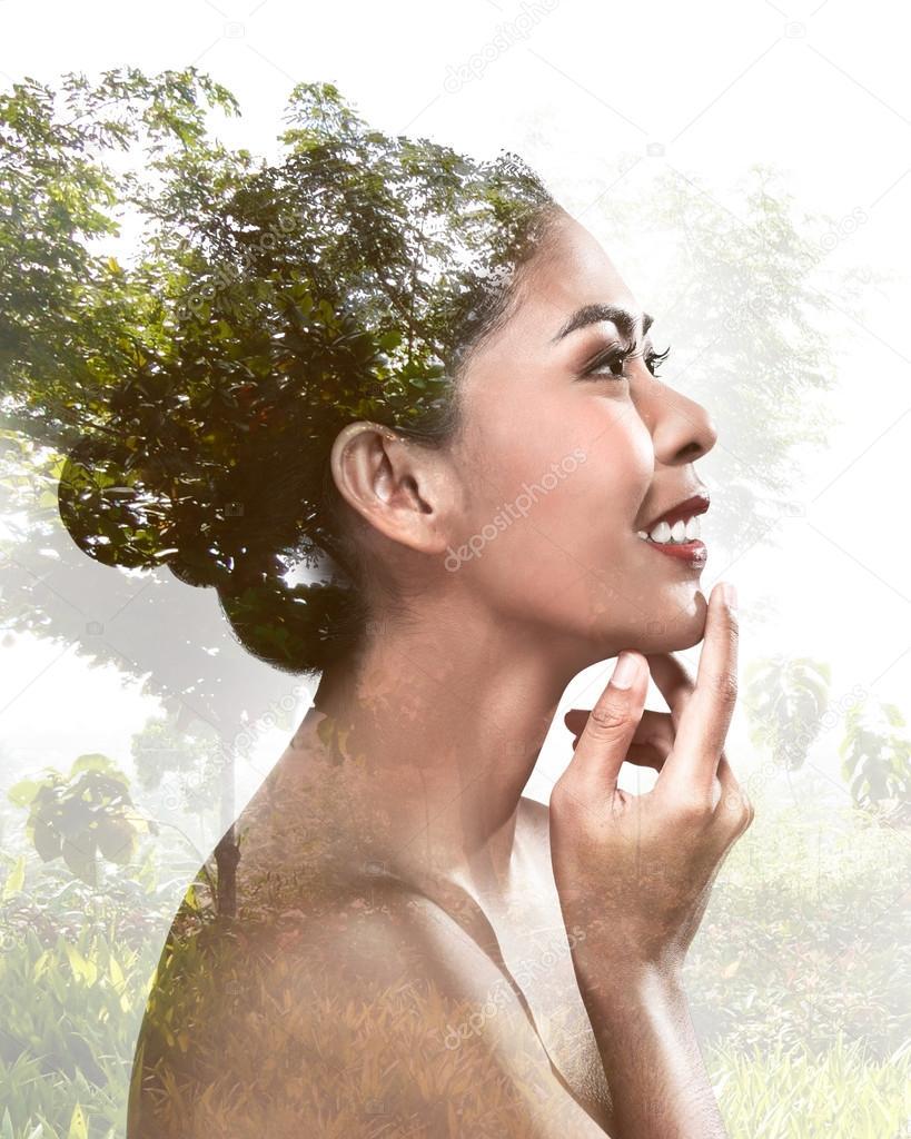 Double exposure portrait of asian woman