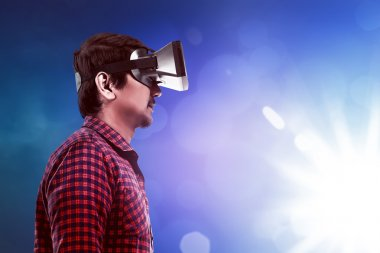 Young asian man wearing VR headset