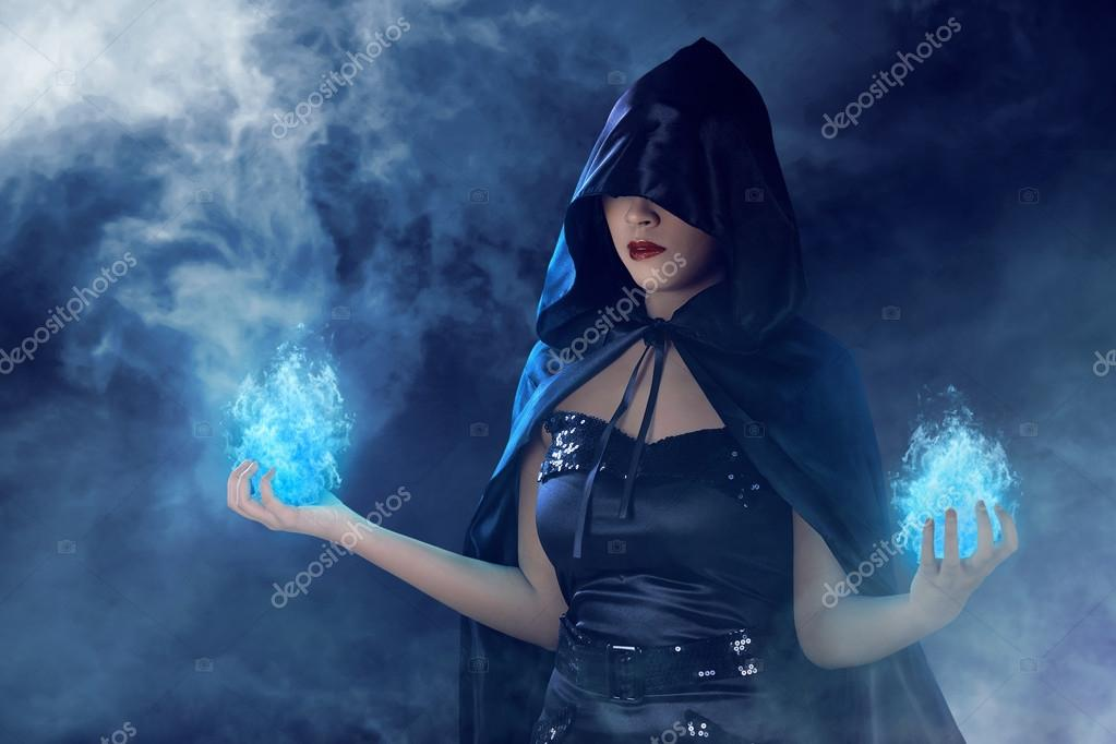 witch woman with blue fire on her hands  u2014 stock photo  u00a9 leolintang  120823344
