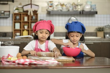 Two Little Girls Making Pizza