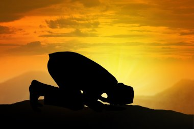 Silhouette Of Muslim Man Praying
