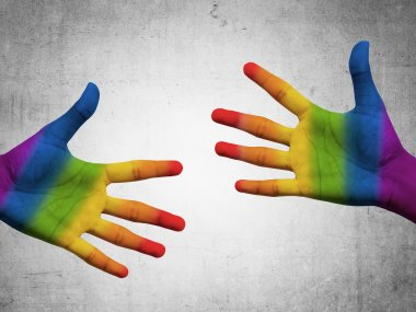 Two hand with gay flag color