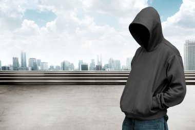 Faceless man in hood