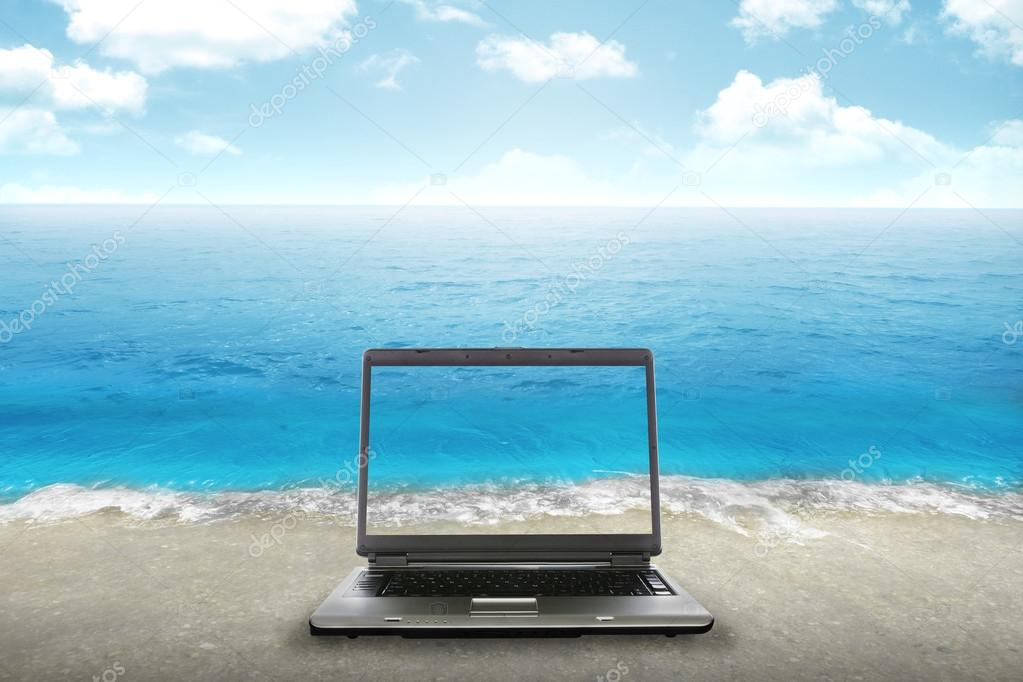Computer laptop on the beach