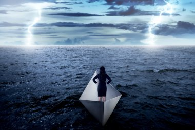 business woman standing alone on the paper boat