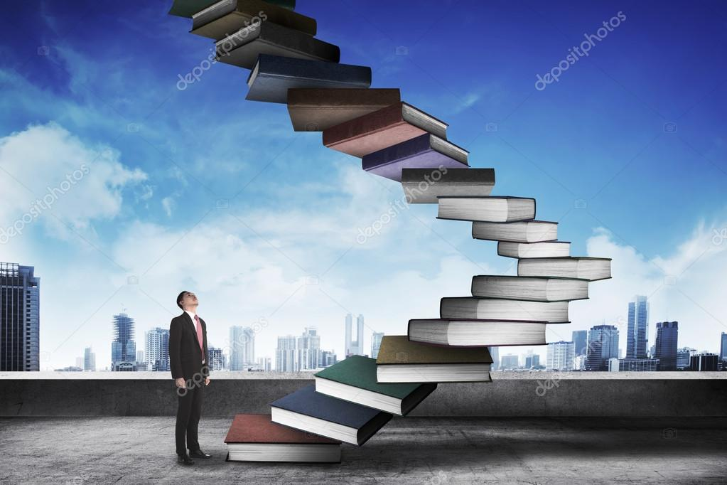 businessman step up flying books