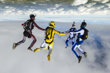 Skydivers collects figure in freefall.