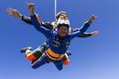 Photo Tandem jump. Flying in free fall