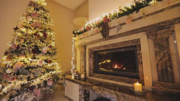Christmas interior in a modern house. Beautiful New Years interior with a Christmas tree and a fireplace.Cozy Christmas interior