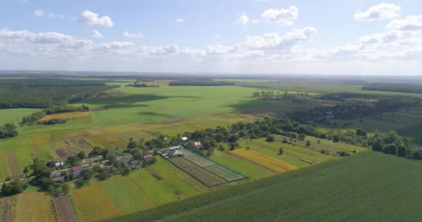 Agriculture aerial view. Farm from the air. Fly over a small air in the countryside. Small farm in the countryside at sunset.