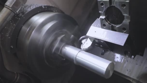 Processing a metal part in a CNC machine. Lathe, cnc machine. CNC lathe machine.