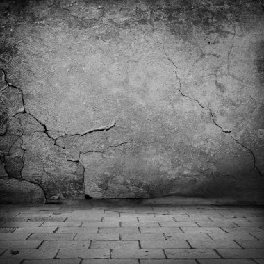 black and white grunge background old stone wall texture and sidewalk bricks urban background