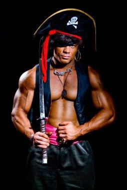 Muscular man in a pirate costume