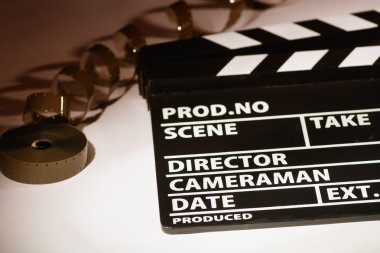 Movie clapper with 16 mm film.