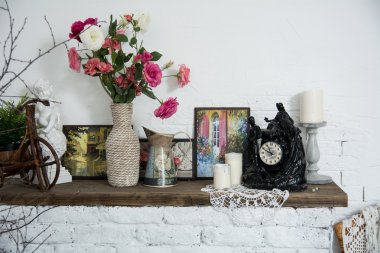 Interior design vases with flowers and candles clock brick firep